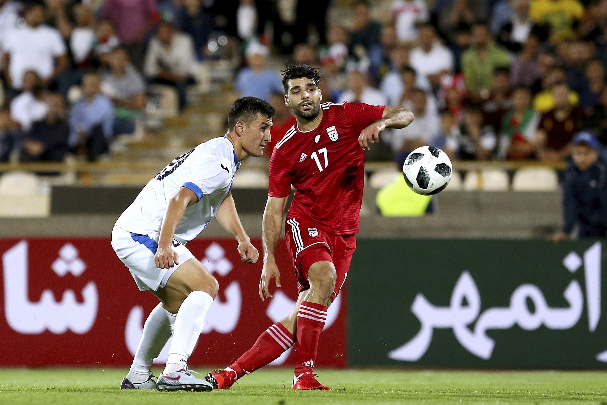 Iran s Mehdi Taremi (R) plays the ball during the international friendly  soccer match between 6394b90cc