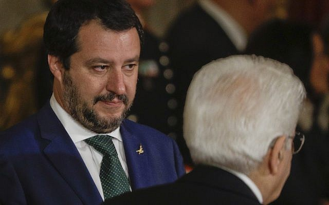 New Italian Interior Minister Matteo Salvini, left, looks at Italian President Sergio Mattarella passing by, during the swearing-in ceremony for Italy's new government at Rome's Quirinale Presidential Palace, Friday, June 1, 2018. (AP Photo/Gregorio Borgia)
