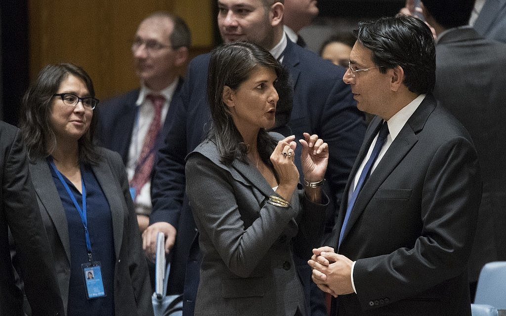 US Ambassador to the United Nations Nikki Haley, left, speaks to Israeli Ambassador to the United Nations Danny Danon before a Security Council meeting on the situation on the Gaza border, Friday, June 1, 2018 at United Nations headquarters. (AP Photo/Mary Altaffer)