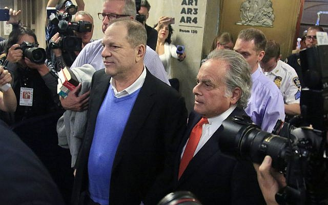 Harvey Weinstein, center, leaves with his lawyer Benjamin Brafman, right, after posting bail at Manhattan's Criminal Court, Friday, May 25, 2018, in New York (AP Photo/Bebeto Matthews)