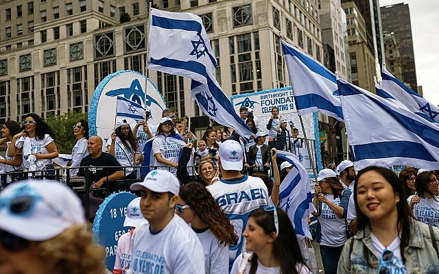 People carry Israeli flags as they march during the annual Celebrate Israel Parade, Sunday, June 3, 2018, in New York. (AP Photo/Andres Kudacki)