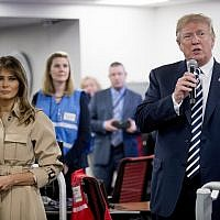 US President Donald Trump, right, accompanied by first lady Melania Trump, left, speaks to employees at the Federal Emergency Management Agency Headquarters, Wednesday, June 6, 2018, in Washington. (AP Photo/Andrew Harnik)