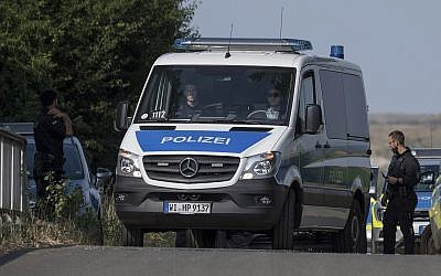 Police officers block a road near Wiesbaden, Germany, June 7, 2018. (Boris Roessler/dpa via AP)
