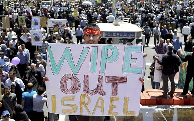 An Iranian protester holds an anti-Israeli placard during an annual anti-Israeli Al-Quds, Jerusalem, Day rally in Tehran, Iran, Friday, June 8, 2018 (AP Photo/Ebrahim Noroozi)