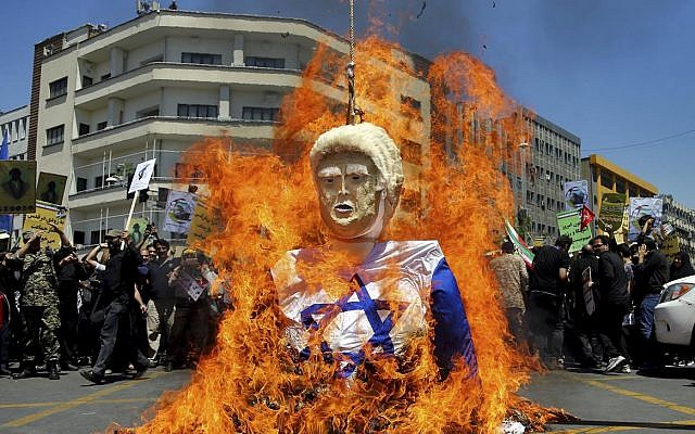 An effigy of US President Donald Trump is set on fire during an annual anti-Israeli Al-Quds, Jerusalem, Day rally in Tehran, Iran, Friday, June 8, 2018 (AP Photo/Ebrahim Noroozi)