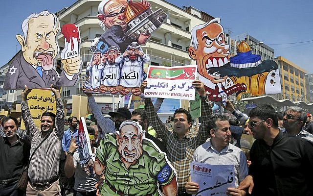 Illustrative: Iranian protesters hold up caricatures of leaders of Israel during the annual anti-Israeli Al-Quds, Jerusalem, Day rally in Tehran, Iran, Friday, June 8, 2018 (AP Photo/Ebrahim Noroozi)