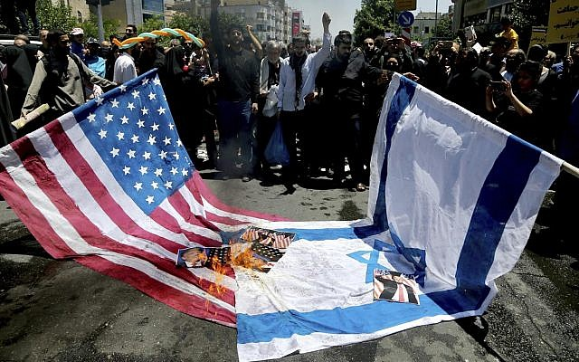 Iranian protesters burn Israeli and US flags in their annual anti-Israeli Al-Quds, Jerusalem, Day rally in Tehran, Iran, Friday, June 8, 2018 (AP Photo/Ebrahim Noroozi)