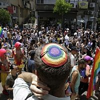 Israelis participate in the Gay Pride parade in Tel Aviv on Friday, June 8, 2018. (AP Photo/Sebastian Scheiner)