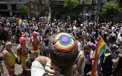 Israelis participate in the Gay Pride parade in Tel Aviv on Friday, June 8, 2018. (AP Photo/Sebastian Scheiner)