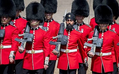 Charanpreet Singh Lall, second right, one of the Coldstream Guards, marches during the Trooping the Colour ceremony at Horse Guards Parade as Queen Elizabeth II celebrates her official birthday, in London, June 9, 2018. (Victoria Jones/PA via AP)