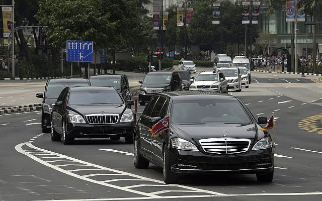 The North Korean motorcade, believed to be carrying North Korean leader Kim Jong Un, travels along Singapore's Orchard Road, June 10, 2018, ahead of the summit with US leader Donald Trump. (AP Photo/Joseph Nair)