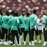 Saudi Arabia head coach Juan Antonio Pizzi, right, instructs his team during the official training session of the Saudi Arabian team one the eve of the group A match between Russia and Saudi Arabia at the 2018 soccer World Cup at Luzhniki stadium in Moscow, Russia, Wednesday, June 13, 2018. (AP Photo/Matthias Schrader)