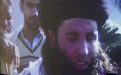 In this image made from video broadcast on November 7, 2013, undated footage of Mullah Fazlullah is shown on a projector in Pakistan (AP Photo via AP Video, File)