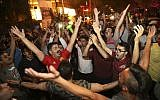 Iranians celebrate the 1-0 victory of their national soccer team over Morocco in the 2018 World Cup, in downtown Tehran, Iran, Friday, June 15, 2018. (AP Photo/Vahid Salemi)