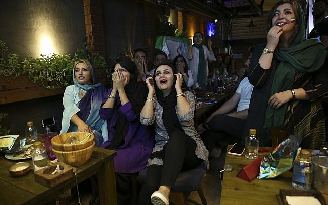 Iranian women react while watching the national soccer team play against Morocco in the 2018 World Cup, in downtown Tehran, Iran, June 15, 2018. (AP Photo/Vahid Salemi)