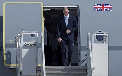 Britain's Prince William disembarks from a Royal Air Force plane after landing at the Marka airport in Amman, Jordan, June 24, 2018. (AP Photo/Nasser Nasser)