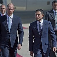 Jordanian Crown Prince Hussein, right, receives Britain's Prince William after his arrival at Marka Airport in Amman, Jordan, June 24, 2018 (AP Photo/Nasser Nasser)