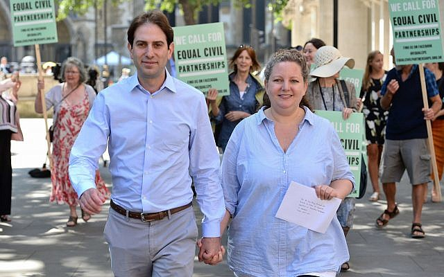 Rebecca Steinfeld (l) and Charles Keidan outside the Supreme Court in London, where they have won their fight for the right to enter into a civil partnership, Thursday June 27, 2018. (Kirsty O'Connor/PA via AP)
