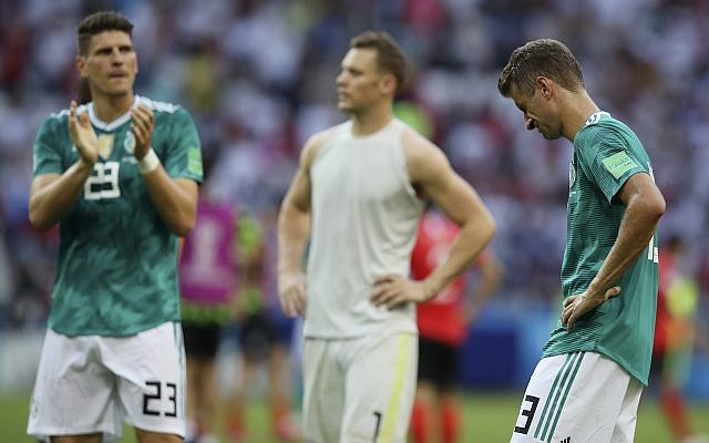 From right, Germany's Thomas Mueller, goalkeeper Manuel Neuer and Mario Gomez walk on the pitch at the end of the group F match between South Korea and Germany, at the 2018 soccer World Cup in the Kazan Arena in Kazan, Russia, June 27, 2018. (AP Photo/Thanassis Stavrakis)