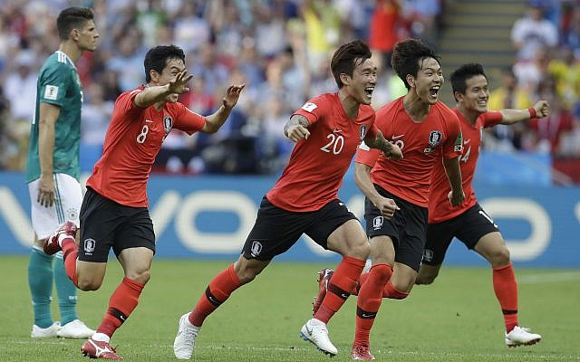 South Korean players celebrate after referee Mark Geiger from the US decided on goal after a VAR review during the group F match between South Korea and Germany, at the 2018 soccer World Cup in the Kazan Arena in Kazan, Russia, June 27, 2018. (AP Photo/Michael Probst)