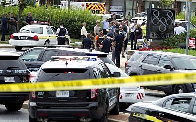 Authorities stage at the office building entrance after multiple people were shot at The Capital Gazette newspaper in Annapolis, Md., June 28, 2018. (AP Photo/Jose Luis Magana)