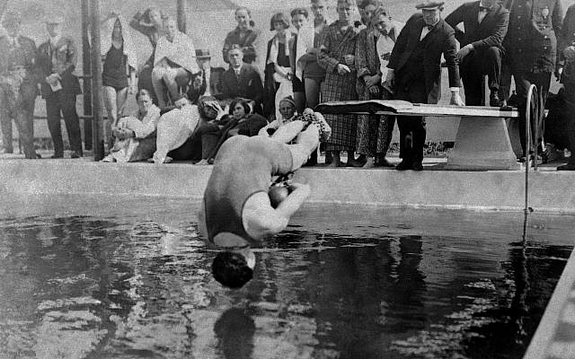 Harry Houdini, handcuffed, and with his feet bound in chains, dives into pool at Los Angeles, May 7, 1923. (AP Photo)