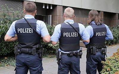 Illustrative photo of German police officers on guard outside the regional court in Frankfurt, Germany, September 15, 2014. (Michael Probst/AP)