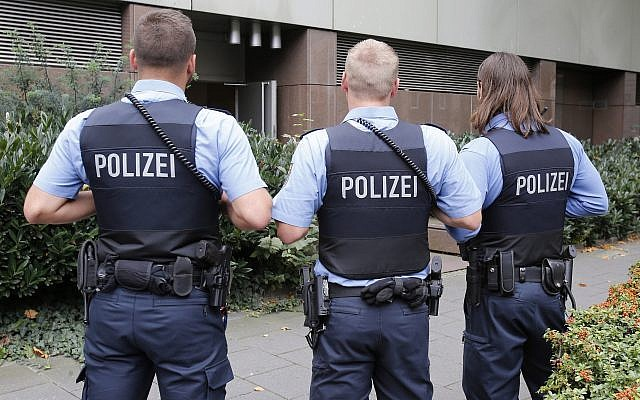 Illustrative: German police officers on guard outside the regional court in Frankfurt, Germany, September 15, 2014. (Michael Probst/AP)