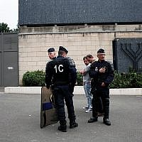 Illustrative photo of police officers standing guard in front of the Sarcelles synagogue, July 21, 2014 (AP Photo/Thibault Camus)
