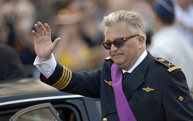 Belgium's Prince Laurent waves as he leaves a church service at the St. Gudule cathedral in Brussels on Sunday, July 21, 2013 (AP Photo/Ezequiel Scagnetti)