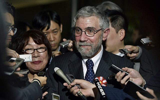 US economist and winner of the Nobel prize in Economics Paul Krugman, center, reacts to questions from journalists in Tokyo, Japan,March 22, 2016. (Franck Robichon/Pool Photo via AP)