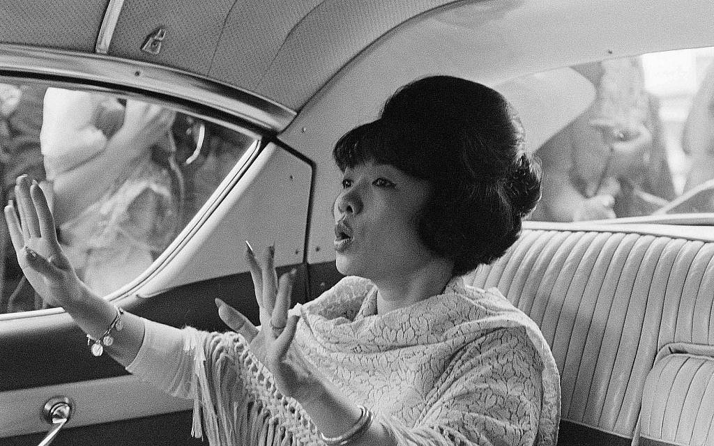 Madame Ngo Dinh Nhu, sister-in-law of Vietnamese President Ngo Dinh Diem, leaves a beauty shop in Rome, Italy, Sept. 26, 1963, after getting an Italian style hairdo. (AP Photo)