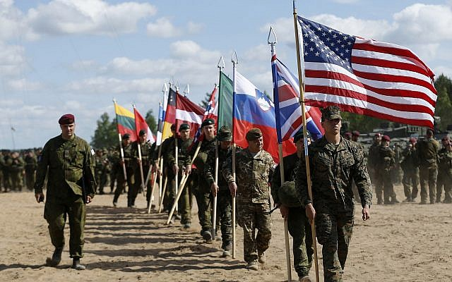 File: Soldiers from NATO countries attend an opening ceremony of military exercise 'Saber Strike 2015', at the Gaiziunu Training Range in Pabrade some 60km north of the capital Vilnius, Lithuania, June 8, 2015 (AP Photo/Mindaugas Kulbis)