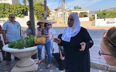 In Kafr Qara, Amna Kanana, founder of Awareness 4U, explains how to prepare for Ramadan, June 2018. (Amanda Borschel-Dan/Times of Israel)