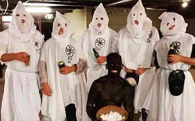 Students from Australia's Charles Sturt University are seen dressed in Ku Klax Klan uniforms and blackface for a 'politically incorrect' themed birthday party. (Twitter)