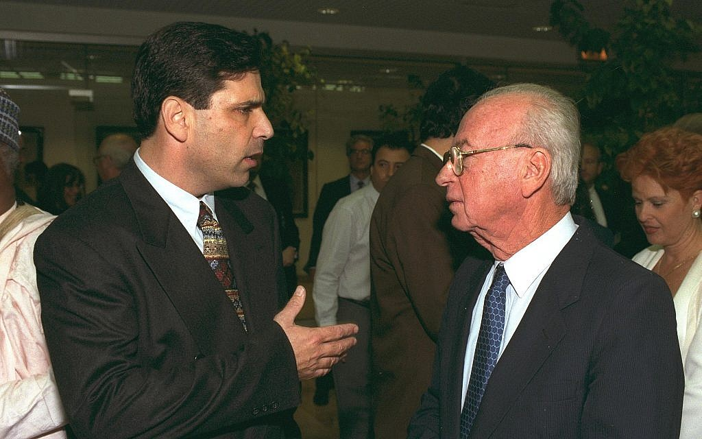 Gonen Segev (L) speaks with then-prime minister Yitzhak Rabin during a conference in Jerusalem. (Government Press Office)