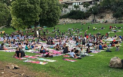 Participants in the local Jerusalem celebration of International Yoga Day received a specially designed yoga mat that together forms an artwork that envisions Jerusalem in thirty years from now (Courtesy The Big Dream - Jerusalem)
