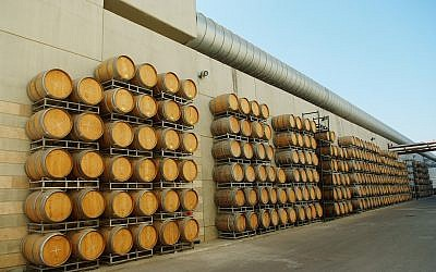Wine barrels piled up at the Barkan winery. August 2, 2012. (Mendy Hechtman/FLASH90)