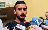 Niv Asraf speaks to press outside his family home in Beersheba on April 6, 2015. (Flash90)