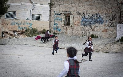 Palestinian schoolgirls play after school in the East Jerusalem neighborhood of Shuafat, March 30, 2016. (Hadas Parush/Flash90)