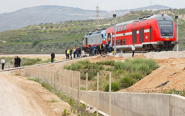 Government officials taking part in a test ride on a new train route near the northern city of Carmiel on March 21, 2017 (Basel Awidat/Flash90)