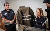 Ina Skivenko, a kindergarten teacher suspected of causing the death of 18-month-old Yasmin Vinta at a kindergarten in Petah Tikva, is brought for a court hearing at a Petah Tikva court on June 3, 2018. (Roy Alima/Flahs90)