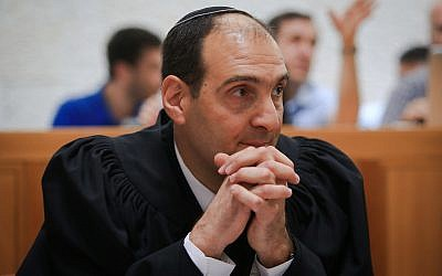 Harel Arnon arrives to defend the Regulation Law on behalf of the state in front of the High Court of Justice on June 3, 2018. (Yonatan Sindel/Flash90)