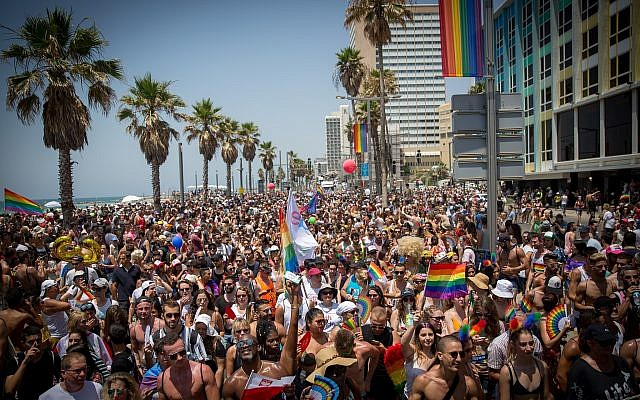 People take part in the annual Gay Pride Parade in Tel Aviv on June 8, 2018. (Miriam Alster/Flash90)