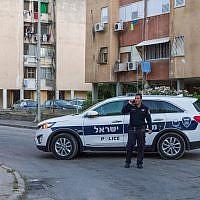 Illustrative: A police vehicle at a suspected murder scene in Haifa, June 10, 2018. (Meir Vaknin/Flash90)