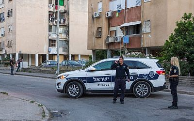 A police vehicle at a suspected murder scene in Haifa where a woman was found dead on June 10, 2018. (Meir Vaknin/Flash90)