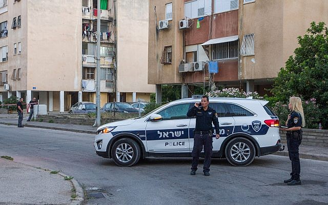 Illustrative: A police vehicle at a suspected murder scene in Haifa, June 10, 2018. (Meir Vaknin/Flash90)
