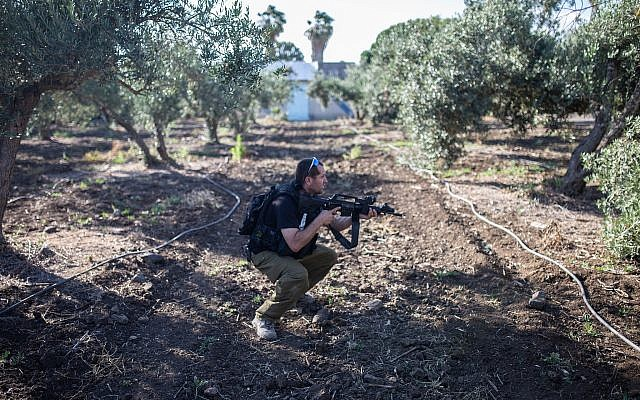 A soldier during an exercise in the Golan Heights on June 11, 2018. (Maor Kinsbursky/FLASH90)