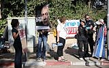 Protesters demonstrate against Prime Minister Benjamin Netanyahu outside his residence in Jerusalem, ahead of the arrival of police investigators coming to question Netanyahu, on June 12, 2018. (Hadas Parush/Flash90)