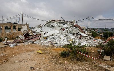 The remains of a bulldozed home in the Netiv Ha'avot outpost on June 13, 2018. (Gershon Elinson/Flash90)